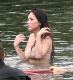 Sexy young starlet Megan Fox goes topless during a scene from the thriller Jennifer's Body shooting in Vancouver.  Fox has some plastic coverings on her nipples as she emerges from the water